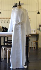 A white shroud displayed on a mannequin